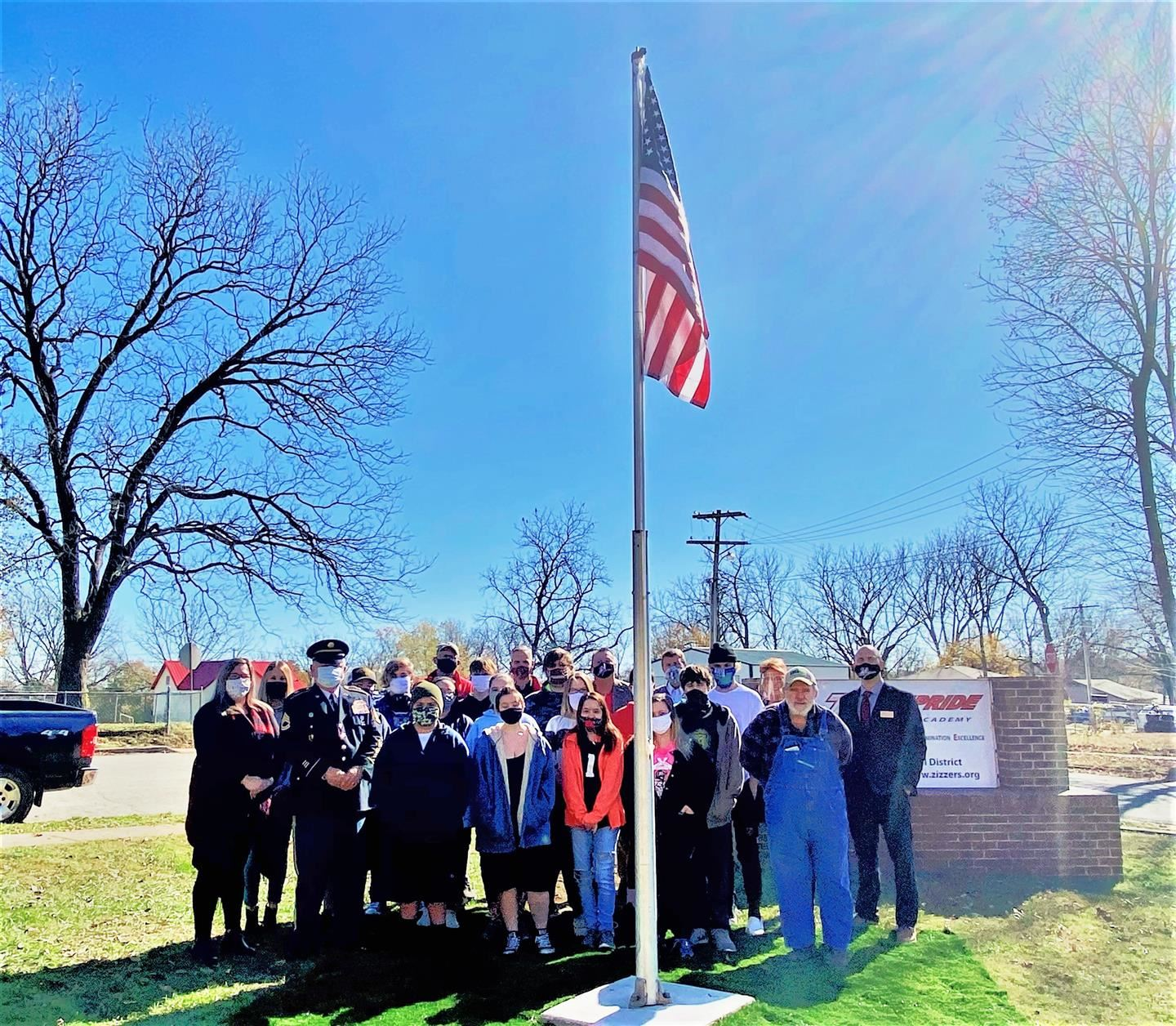 New Flag Pole Installed at the Zizzer Pride Academy Thanks to the VFW & DAV